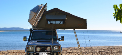 Boat loader with car topper and roof top tent